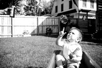 Family plays with bubbles in back yard Milwaukee photo