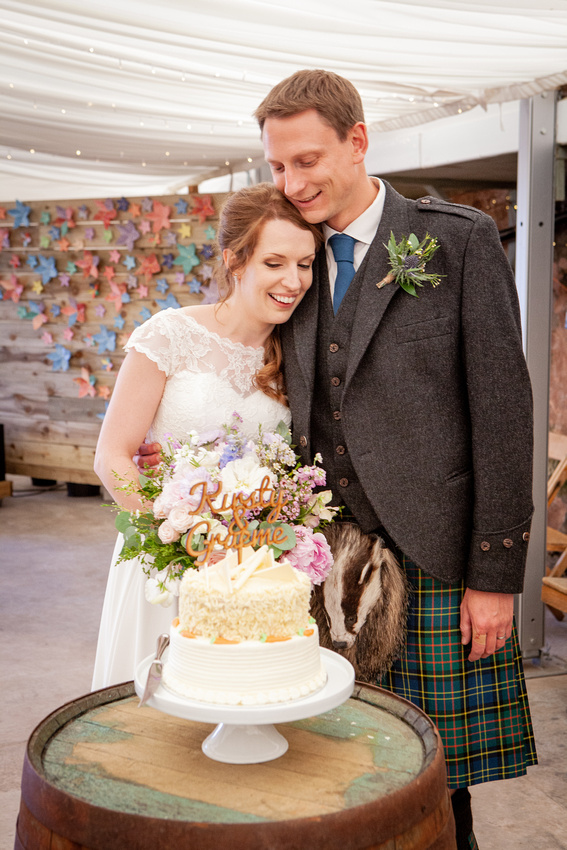 Travel Adventure Wedding Photographer from Milwaukee Wisconsin to Scotland Groom in Kilt Bride and Groom Kissing